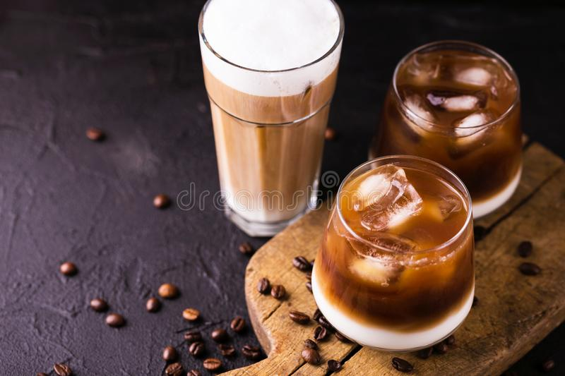 Iced coffee in glasses with milk. Black background royalty free stock image