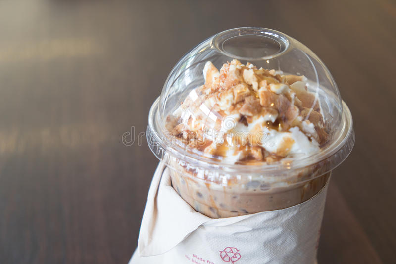 Iced coffee latte topped with whipped cream stock photos