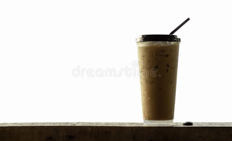 Iced coffee in a plastic glass on wooden , white background. Thailand stock photo