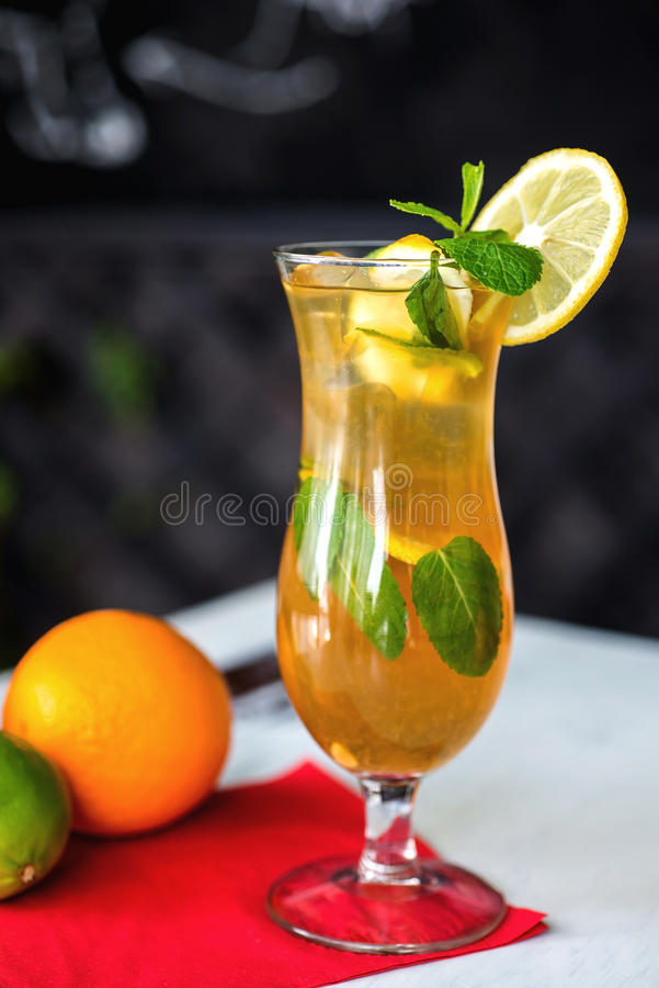 Iced drink with mint and citrus fruit. Selective. Iced drink with mint and citrus fruit royalty free stock photography