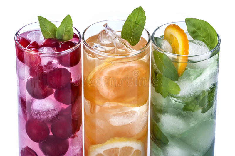 Iced drinks. With cherry, orange and mint on white background royalty free stock photography