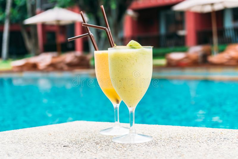 Smoothies with pool background. Iced fruit smoothies with pool background stock photo