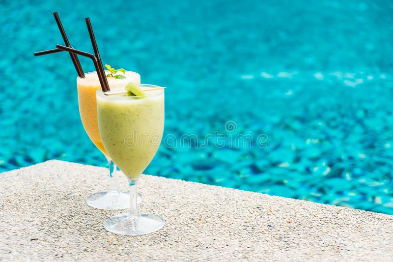 Smoothies with pool background. Iced fruit smoothies with pool background stock image
