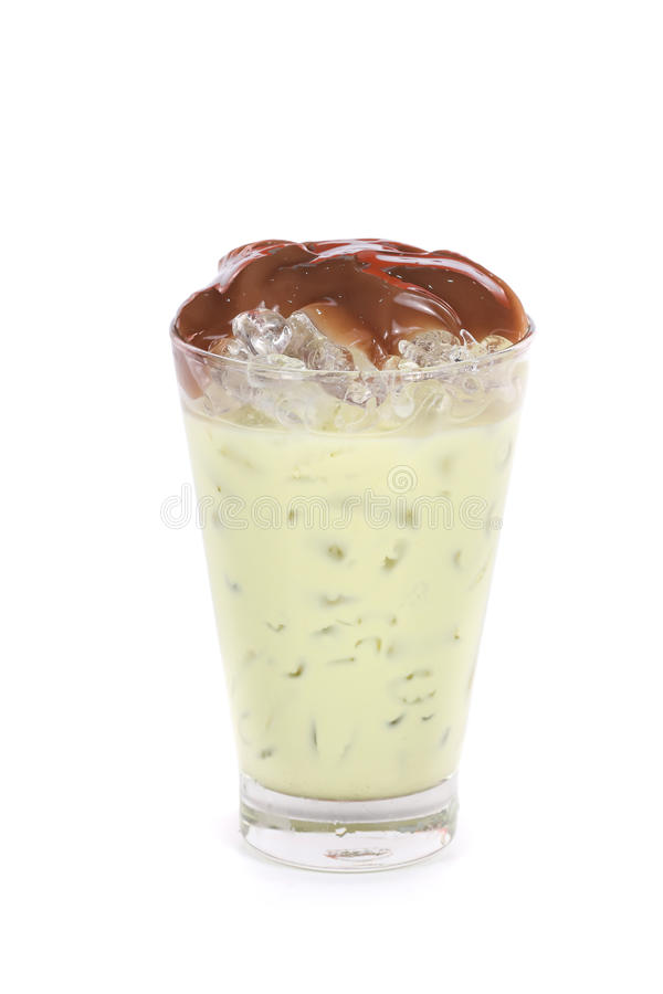 Iced green tea latte in a glass stock photo