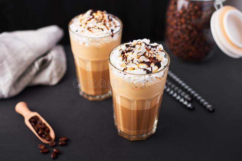 Iced caramel latte coffee in a tall glass stock image