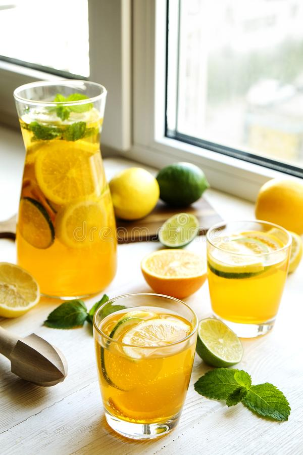 Summer healthy non alcoholic cocktails, citrus infused water drinks, lemonades with lime lemon or orange, diet detox beverages. stock image