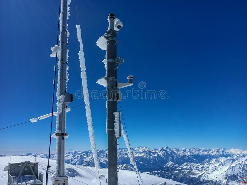 Iced masts and poles on top of Klein Matterhorn mountain, Switzerland stock image