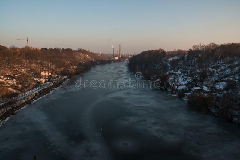 Iced river Zhytomir. Iced river Teteriv Zhytomir Kyiv district in winter. Sunset stock photo