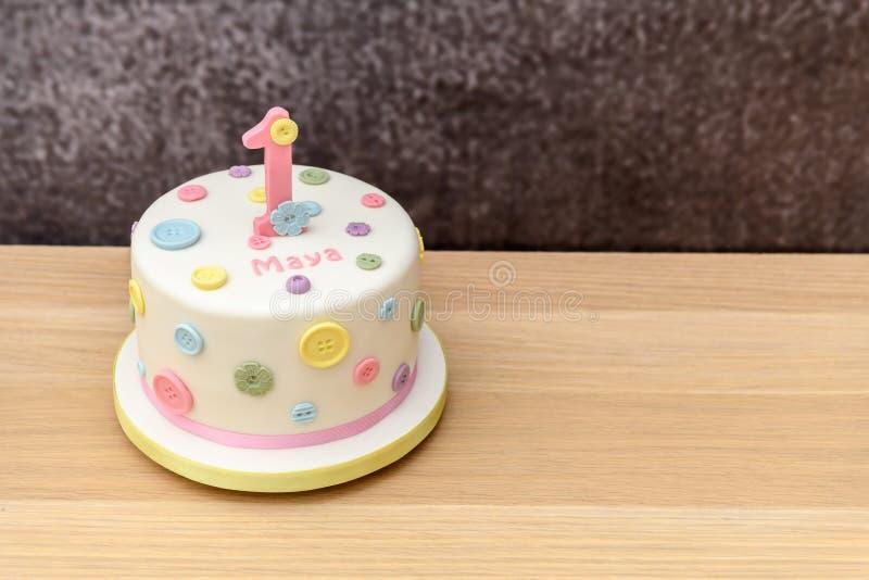Iced 1st Birthday Cake stock image