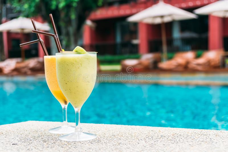 Smoothies with pool background. Iced t smoothies with pool background stock photography