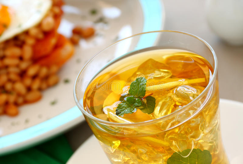 Iced Tea. Delightful mint and lemon iced tea for a refreshing beverage royalty free stock photo