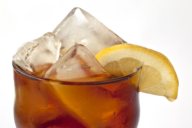 Iced tea. Cold iced tea with lemon on bed of ise royalty free stock photos