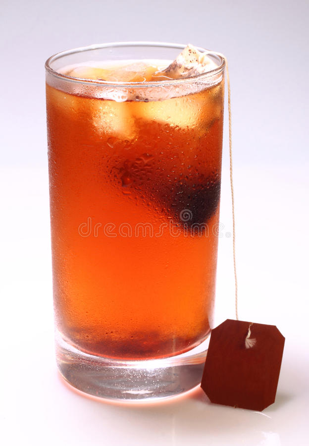 Iced tea. A glass of iced tea drink isolated on a white background royalty free stock images