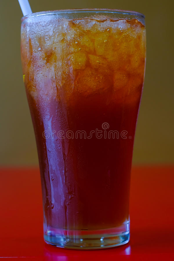 Iced tea. With lemon and mint on wooden table stock image