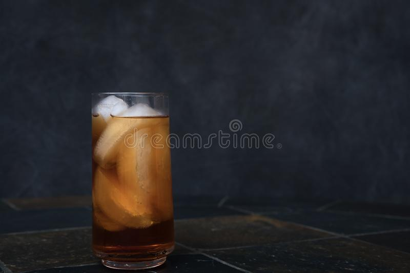 Iced Tea on countertop. Iced Team on stone countertop with dark background royalty free stock image