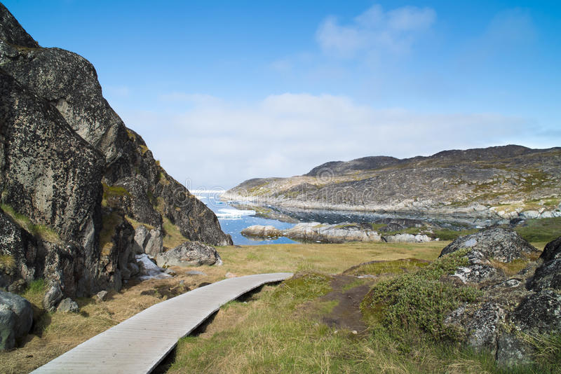 Icefjord Ilulissat, Greenland. Wooden trail to Icefjord Ilulissat, Greenland stock image