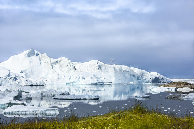 Icefjord Ilulissat, Greenland. Beautiful icebergs Iicefjord Ilulissat, Greenland. Icebergs reflecting in Fjord stock photo