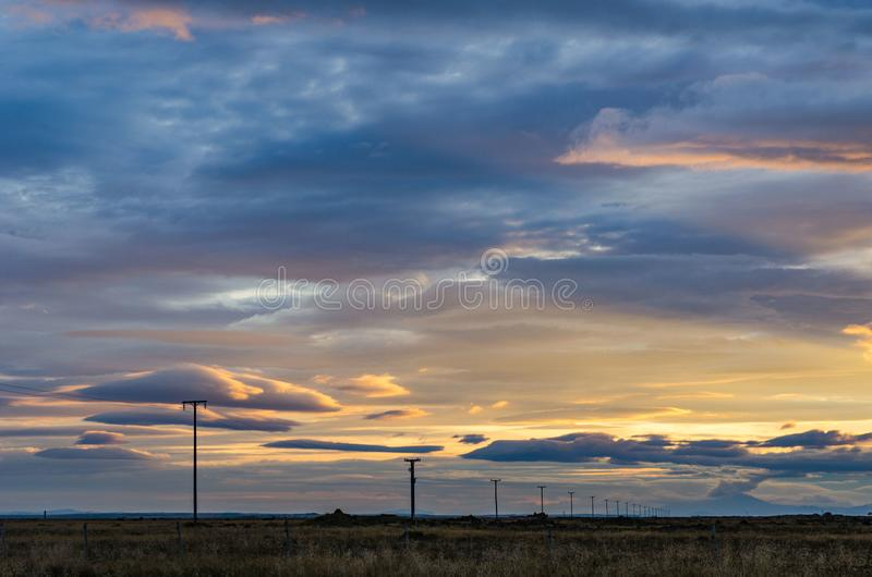 Iceland, autumn, sunrise, Typical icelandic landscape. Electric poles extending into the distance. Typical icelandic landscape Iceland autumn, Electric poles royalty free stock photo