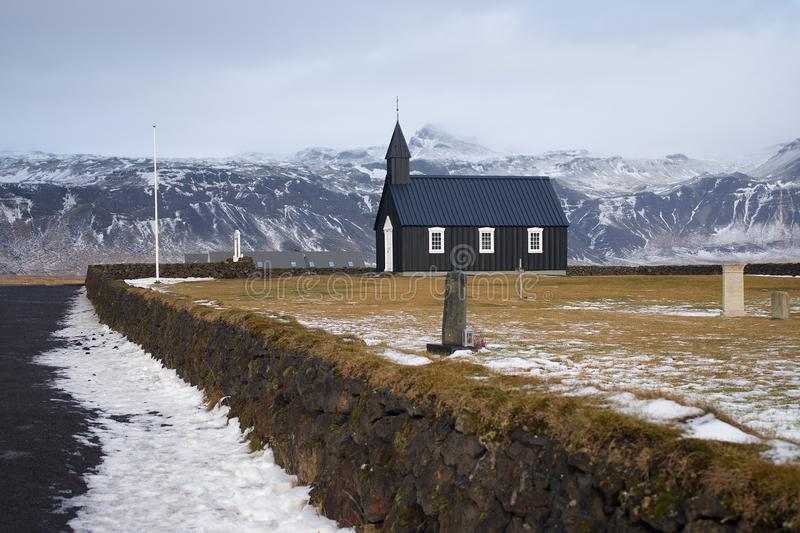 Iceland black church with mountains in winter stock photo
