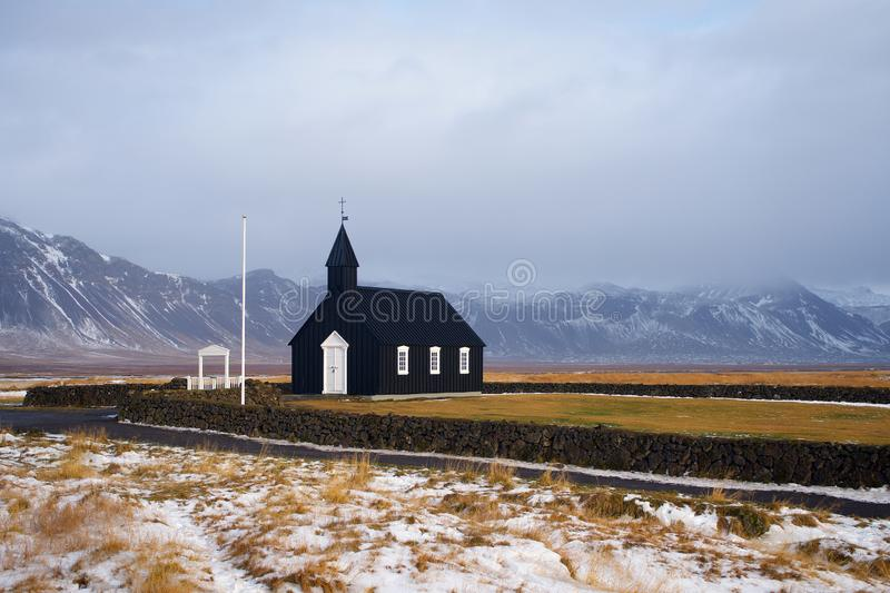 Iceland black church with mountains in winter royalty free stock photos