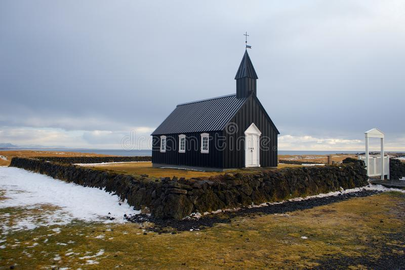 Iceland black church with mountains in winter royalty free stock photography