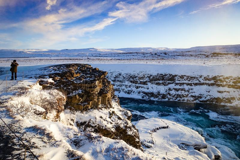 Iceland Canyon with rear view of person frozen river royalty free stock image