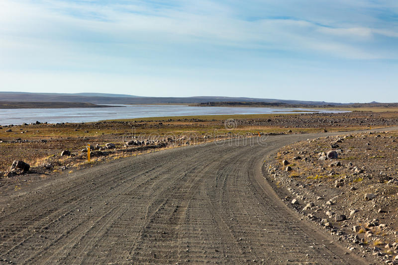Iceland Dirt Road Through Stone Field And A River. Royalty Free Stock Photos