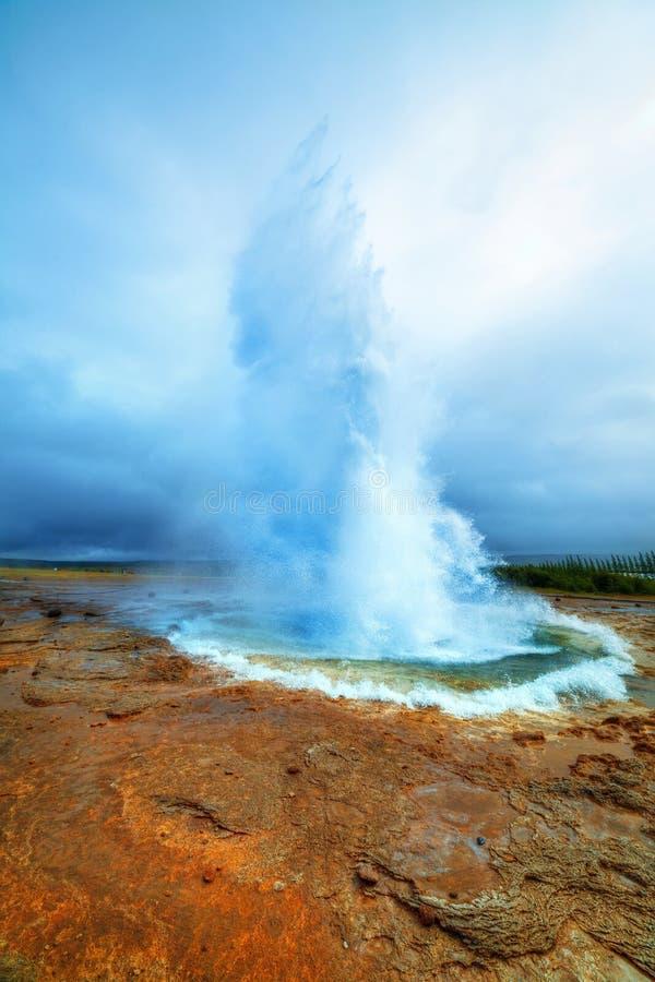 Iceland. Eruption of Strokkur Geyser in Iceland. Vertical view royalty free stock photos