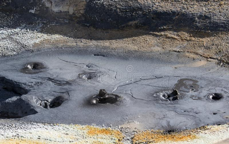 Iceland geothermal zone Namafjall - area in field of Hverir. Landscape which pools of boiling mud and hot springs. Tourist and. Iceland geothermal. Namafjall royalty free stock image