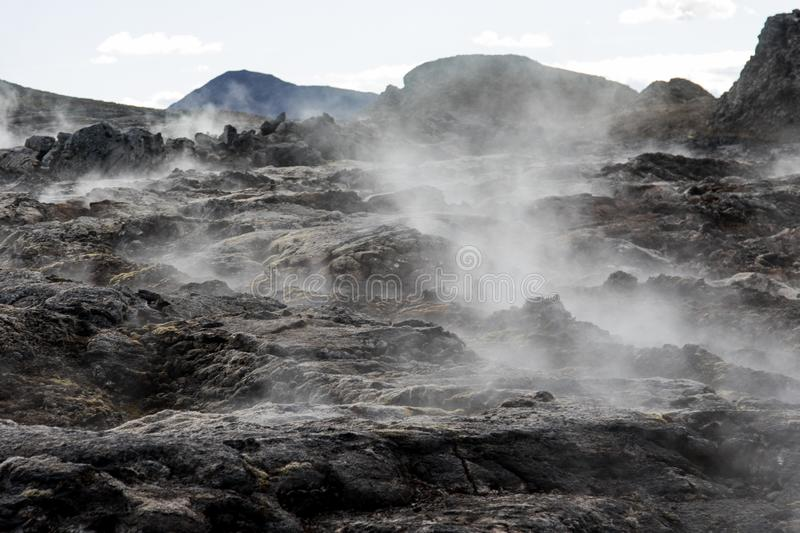 Iceland geothermal zone Namafjall - area in field of Hverir. Landscape which pools of boiling mud and hot springs. Tourist and. Iceland geothermal. Namafjall royalty free stock images