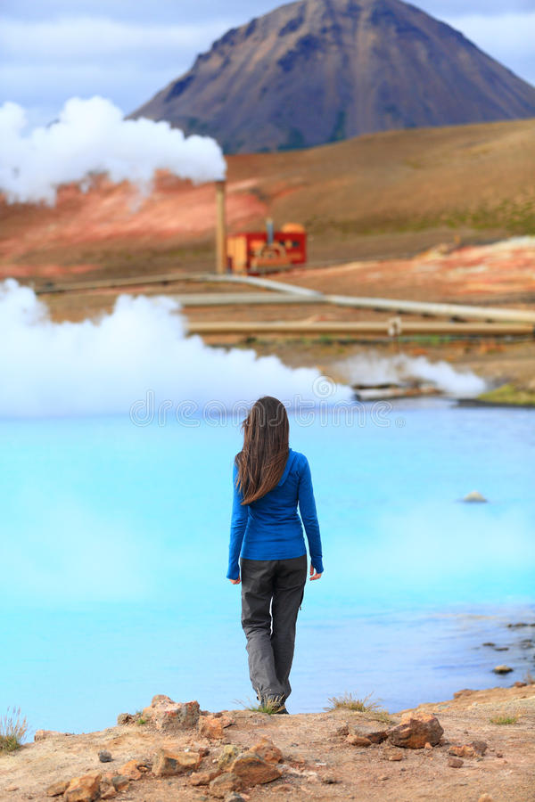Iceland hot spring geothermal energy power plant. In Námafjall in Lake Myvatn area. Woman tourist enjoying Icelandic nature landscape on Route 1 Ring Road stock image