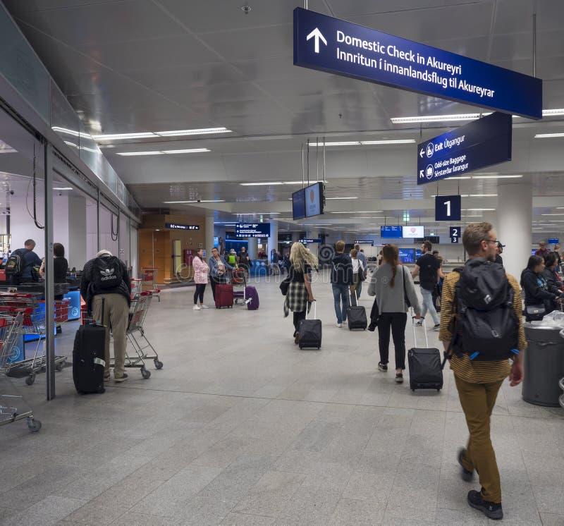 Iceland, Keflavik, July 30, 2019: Tourist people visiting Iceland leaving Keflavik Airport. Iceland, Keflavik, July 30, 2019: Tourist people visiting Iceland are royalty free stock photo