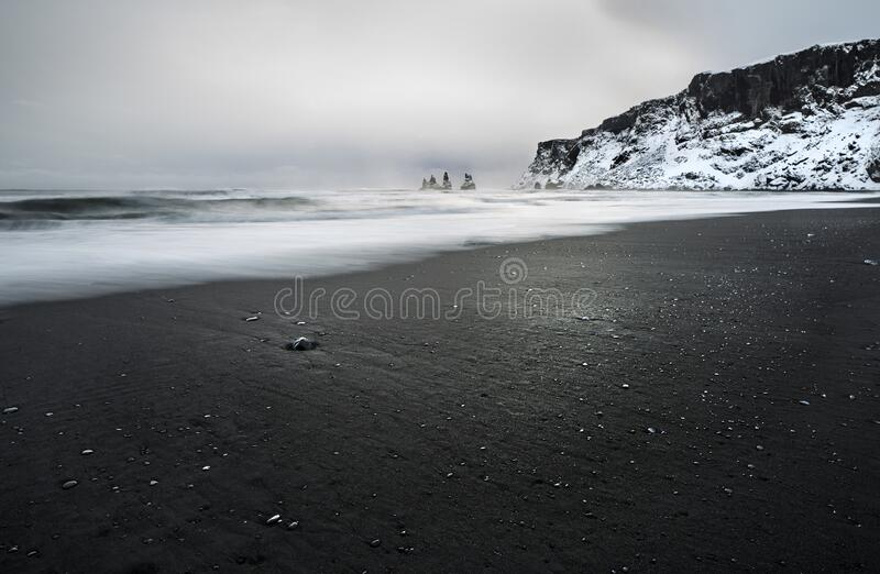 Iceland landscape. Amazing  Iceland, breathtaking calm landscape, beautiful beach with black volcanic sand and famous basalt columns in the ocean, Vik Myrdal royalty free stock photos
