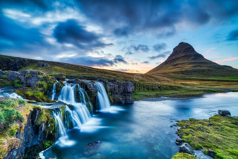 Iceland Landscape Summer Panorama, Kirkjufell Mountain at Dusk with Waterfall in Beautiful Light royalty free stock images