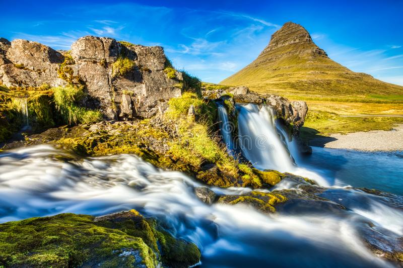 Iceland Landscape Summer Panorama, Kirkjufell Mountain during a Sunny Day with Waterfall in Beautiful Light stock images