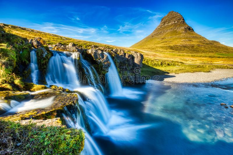 Iceland Landscape Summer Panorama, Kirkjufell Mountain during a Sunny Day with Waterfall. In Beautiful Light stock image