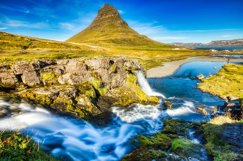 Iceland Landscape Summer Panorama, Kirkjufell Mountain during a Sunny Day with Waterfall in Beautiful Light. Iceland royalty free stock photos