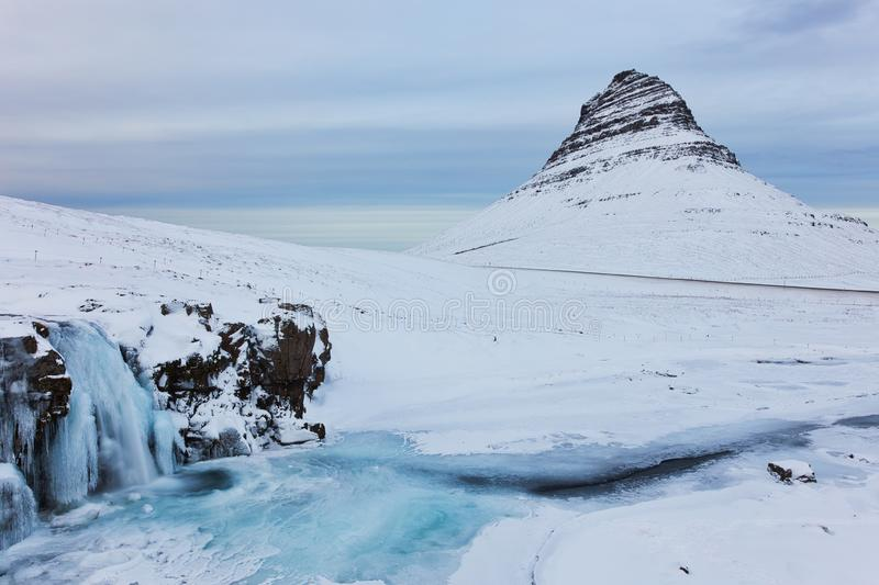 Iceland Landscape Winter Panorama, Kirkjufell Mountain Covered by Snow with Waterfall stock image
