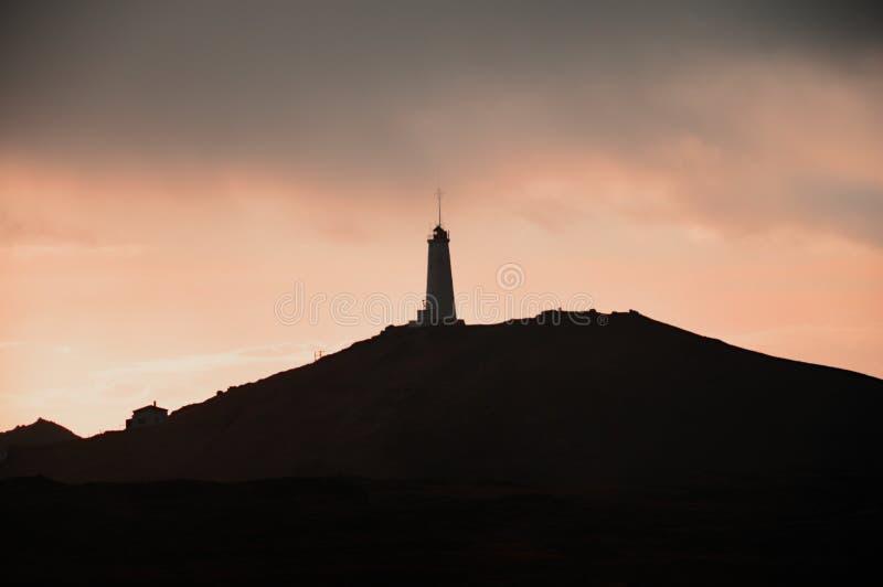 Iceland latarnia morska przy półmrokiem zdjęcia stock