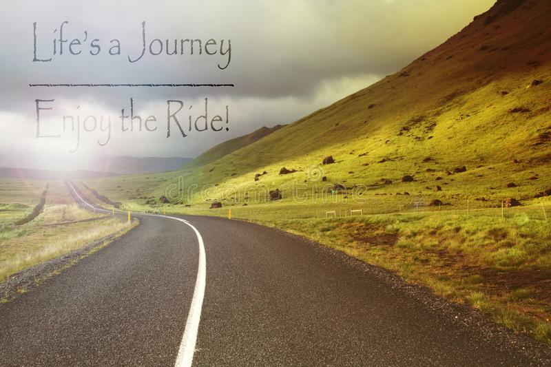 Motivational quote to live the life on abstract road and hills. Iceland stock images