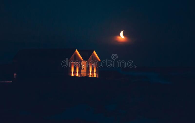 Iceland night scape. Litten by the moonlight and the lanterns, dreamy dark background stock images