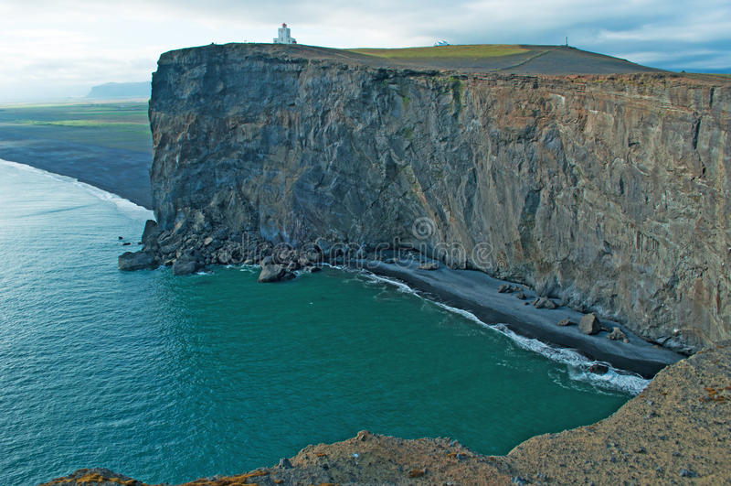 Iceland, Northern Europe, Dyrholaey, lighthouse, Vik, nature, landscape, climate change. Panoramic view of the cliffs with the Dyrholaey lighthouse on August 18 royalty free stock photography