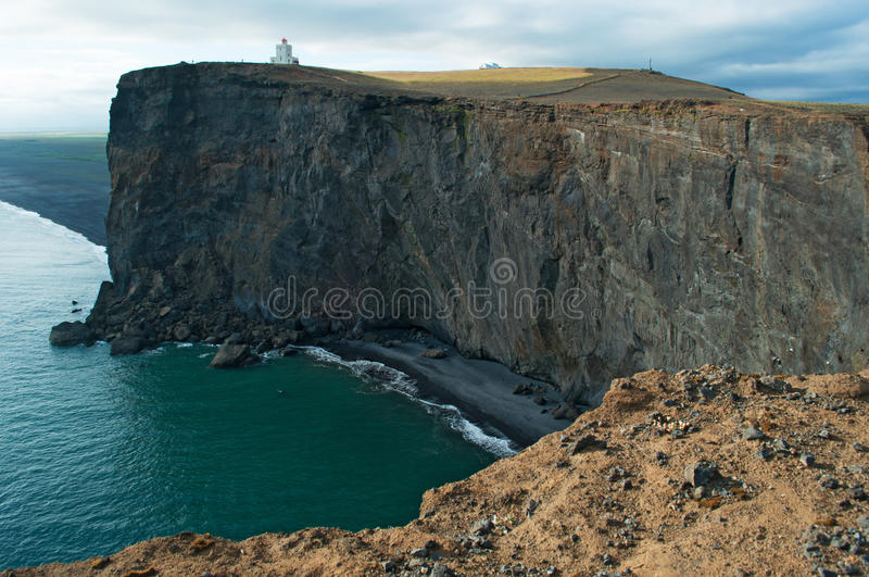 Iceland, Northern Europe, cliff, lighthouse, Dyrholaey, basalt, landscape, nature. Panoramic view of the cliffs with the Dyrholaey lighthouse on August 18, 2012 stock images
