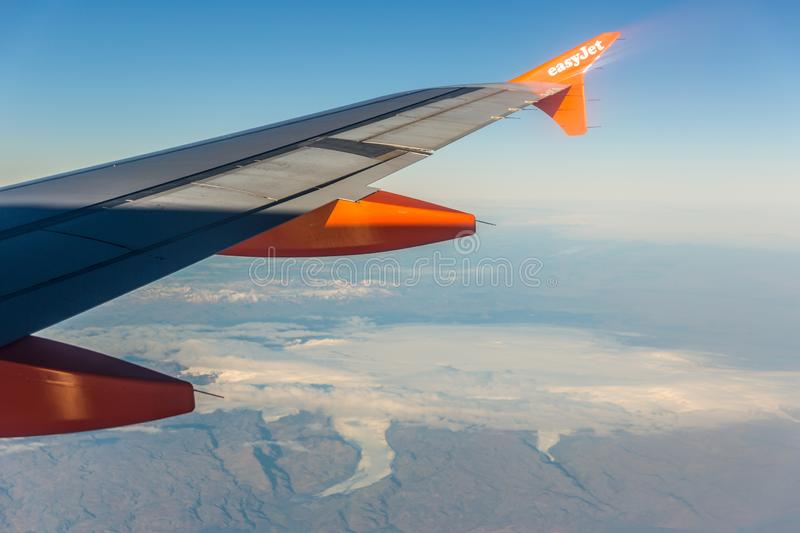 Iceland, Oct 15th 2017 - Easyjet airplane flying over the Iceland in a blue sky day. stock images