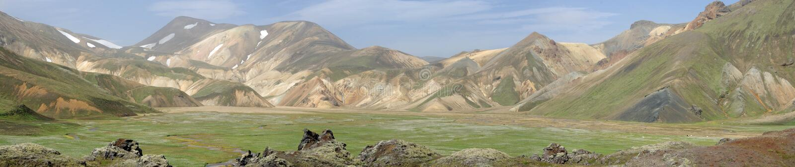 Iceland panoramic view of Landmannalaugar and these colorful mountains. There are mountains, a green plain, fields of ashes royalty free stock photography