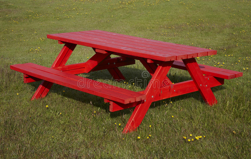 Iceland. Red camping table and grass ground. stock photo