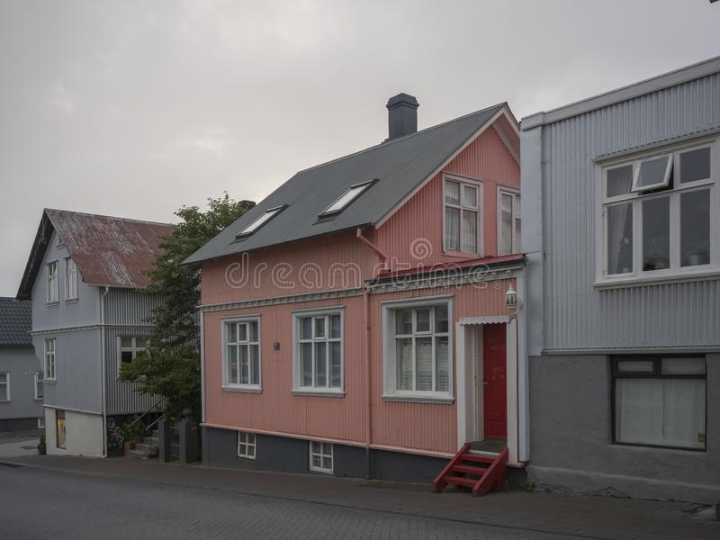 Iceland, Reykjavik, July 30, 2019: street in Reykjavik center with old historic pink and gray sheet metal houses stock photo
