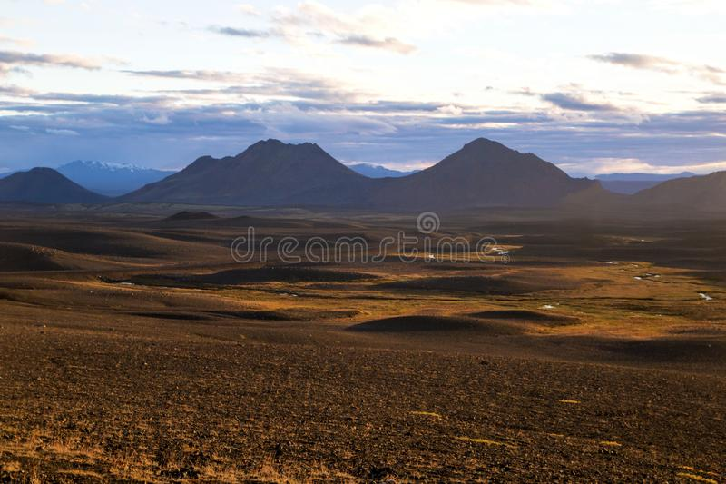 Iceland`s inland. Central Highlands of Iceland, red brown mountain landscape shaped by volcanic activity. Central Highlands of Iceland, red brown mountain royalty free stock image
