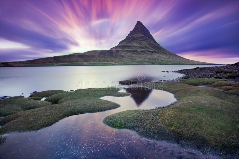 Iceland snaefellsnes peninsula and famous Kirkjufell. Kirkjufell is a beautifully shaped and a symmetric, free standing mountain royalty free stock images