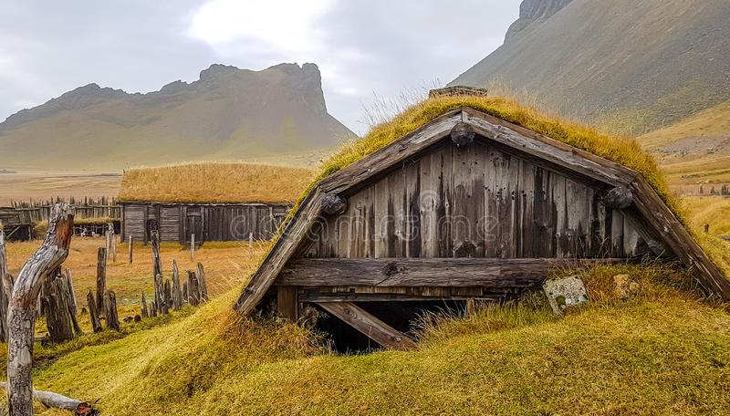 Iceland - Sod rooftop viking village. An abandoned vikings village. Sod rooftops, turf rooftops. Village located at the bottom of a high mountain. Around the stock images